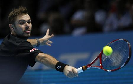 Stanislas Wawrinka of Switzerland hits a return during his men's singles tennis match against Rafael Nadal of Spain at the ATP World Tour Finals at the O2 Arena in London November 6, 2013. REUTERS/Suzanne Plunkett