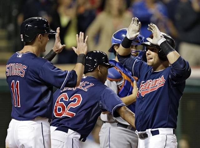 Cleveland Indians' Nick Swisher, right, celebrates with Drew Stubbs (11) and Jose Ramirez (62) after a grand slam off New York Mets relief pitcher Tim Byrdak in the eighth inning of a baseball game Friday, Sept. 6, 2013, in Cleveland. (AP Photo/Mark Duncan)