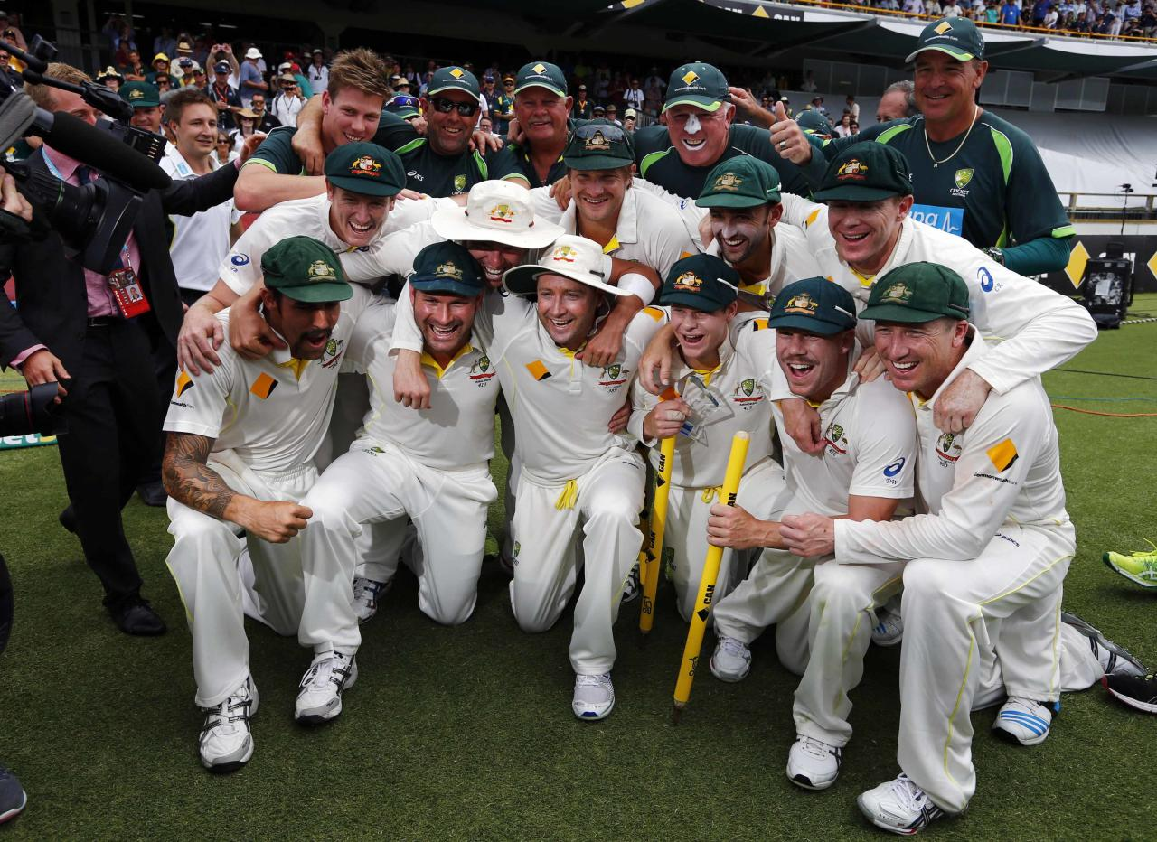 Australia's players pose for pictures after winning the Ashes test cricket series against England at the WACA ground in Perth December 17, 2013. Australia beat England by 150 runs in the third test at the WACA on Tuesday to take an unassailable 3-0 lead in the five-match series and reclaim the Ashes. REUTERS/David Gray (AUSTRALIA - Tags: SPORT CRICKET)