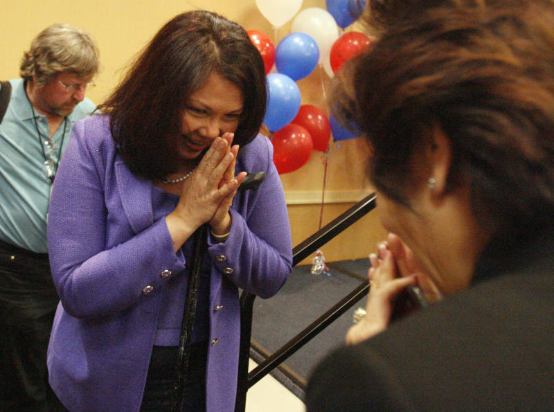 Tammy Duckworth thanks Nancy Suvarnamani, of Chicago, after speaking to supporters in Elk Grove Village, Ill., following her win in Illinois 8th Congressional District Democratic primary on March 20, 2012.  Duckworth will face outspoken Republican Congressman Joe Walsh in November.   (AP Photo/Daily Herald, George LeClaire) MANDATORY CREDIT, MAGS OUT, TV OUT