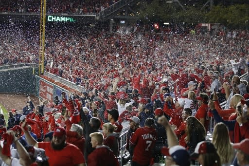 Washington Nationals fans celebrate after Game 4 of the baseball National League Championship Series against the St. Louis Cardinals Wednesday, Oct. 16, 2019, in Washington. The Nationals won 7-4 to win the series 4-0. (AP Photo/Alex Brandon)