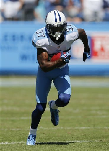 Tennessee Titans special teams player Tommie Campbell runs a punt back 65 yards for a touchdown after taking a pass from kick-returner Darius Reynaud against the Detroit Lions in the first quarter of an NFL football game on Sunday, Sept. 23, 2012, in Nashville, Tenn. (AP Photo/Joe Howell)