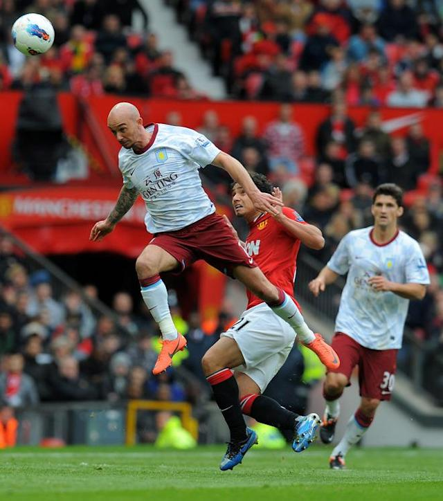 "Aston Villa's Irish midfelder Stephen Ireland (L) and Manchester United's Brazilian defender Rafael Da Silva (2L) compete during the English Premier League football match between Manchester United and Aston Villa at Old Trafford in Manchester, north-west England, on April 15, 2012. RESTRICTED TO EDITORIAL USE. No use with unauthorized audio, video, data, fixture lists, club/league logos or ""live"" services. Online in-match use limited to 45 images, no video emulation. No use in betting, games or single club/league/player publications (Photo by Andrew Yates/AFP/Getty Images)"