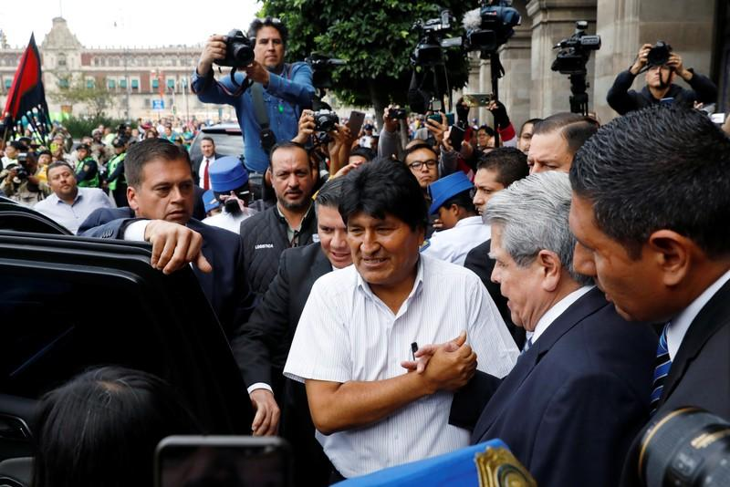Bolivia's ousted president Evo Morales leaves after a ceremony where he was recognized as a distinguished guest, outside the town hall in Mexico City