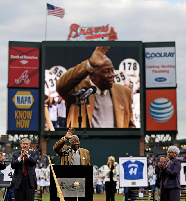 Hank Aaron waves to the crowd during a ceremony celebrating the 40th anniversary of his 715th home run before the start of a baseball game between the Atlanta Braves and the New York Mets, Tuesday, April 8, 2014, in Atlanta. (AP Photo/David Goldman)