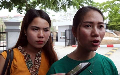 Pan Ei Mon, right, wife of Reuters journalist Wa Lone, talks to journalists as she leaves the Supreme Court along with Chit Su Win, left, wife of Reuters journalist Kyaw Soe Oo - Credit: AP
