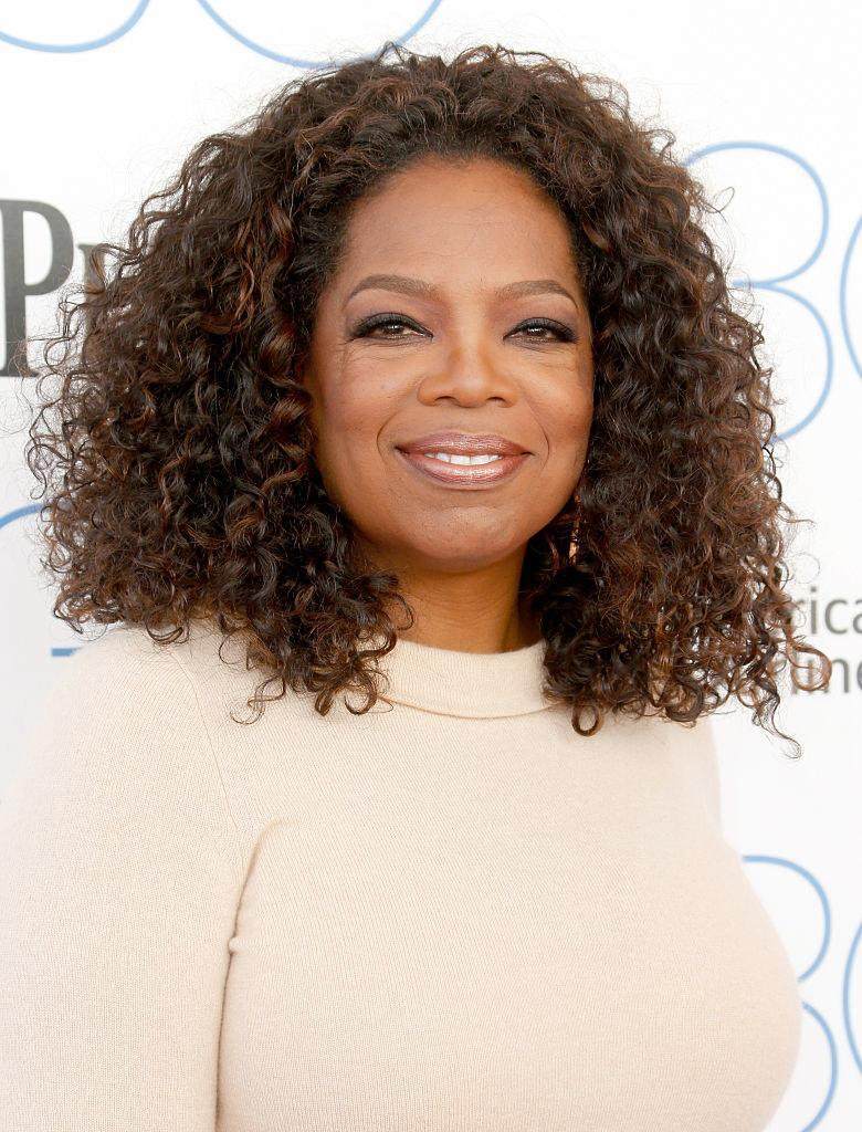 Winfrey smiling in a cashmere sweater