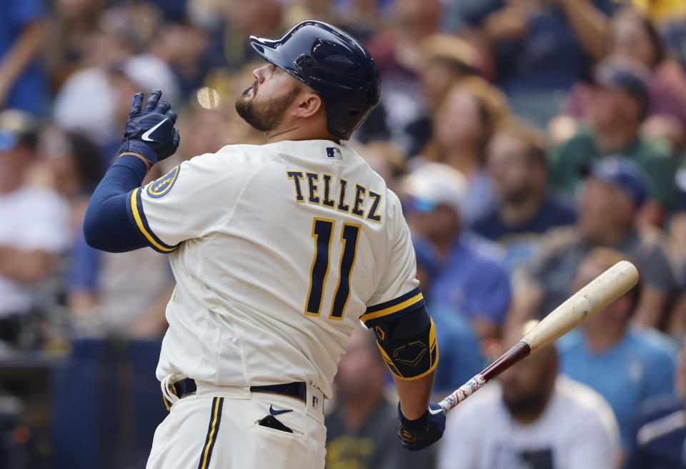 Milwaukee Brewers' Rowdy Tellez watches his three-RBI pinch hit home run against the Pittsburgh Pirates during the seventh inning of a baseball game Wednesday, Aug. 4, 2021, in Milwaukee. (AP Photo/Jeffrey Phelps)