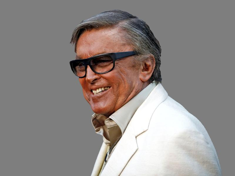 Robert Evans headshot, movie producer, graphic element on gray