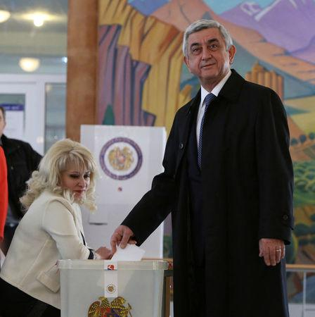 Armenia's President Sarksyan casts his ballot during a parliamentary election at a poling station in Yerevan