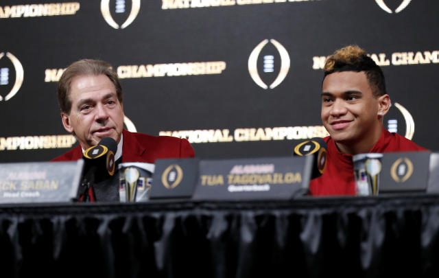 Alabama head coach Nick Saban, left, speaks next to quarterback Tua Tagovailoa during a press conference in Atlanta, Tuesday, Jan. 9, 2018. Alabama beat Georgia in overtime to win the NCAA college football playoff championship game. (AP Photo/David Goldman)