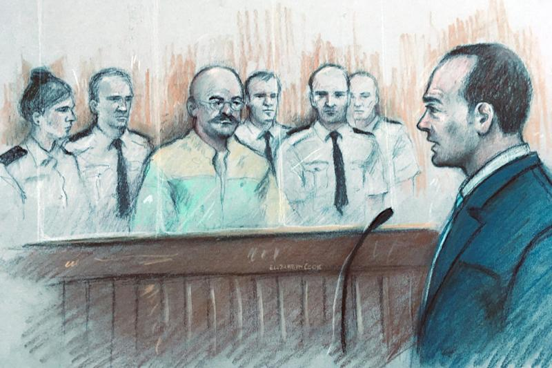 Court sketch of Charles Bronson listening to Mark Docherty give evidence at Leeds Crown Court: PA