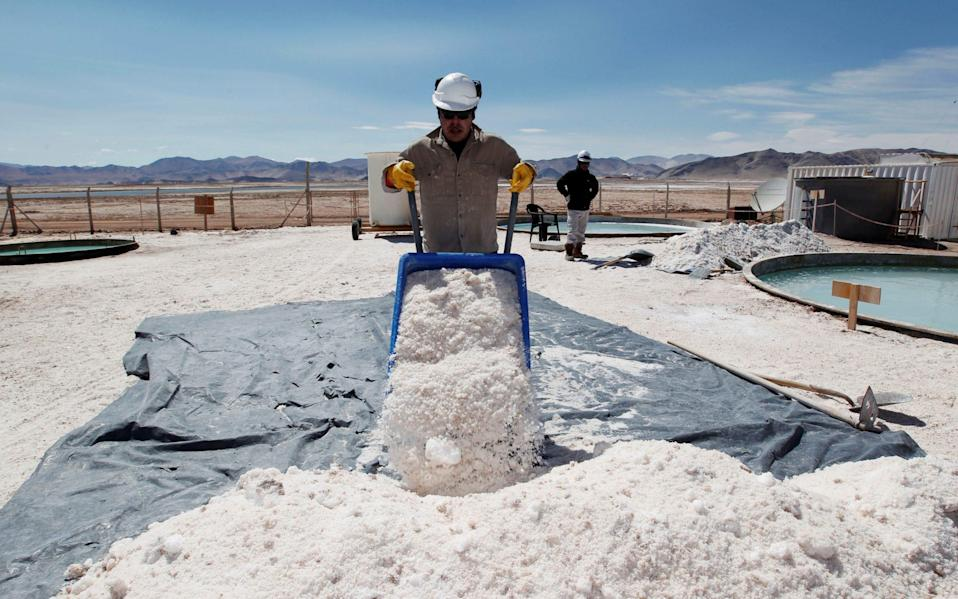 Braulio Lopez of Galaxy Resources lithium mining division carts halite concentrate at the Salar del Hombre Muerto in Salta Province
