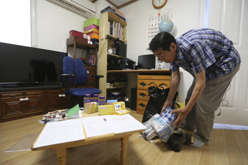In this Aug. 17, 2018, photo, Lee Soo-nam, 76, arranges gifts for family members of his brother Ri Jong Song in North Korea during an interview at his home in Seoul, South Korea. Lee is among about 200 war-separated South Koreans and their family members who are crossing into North Korea for heart-wrenching meetings with relatives they haven't seen for decades. The week-long event beginning Monday, Aug. 20, 2018, at North Korea's Diamond Mountain resort come as the rival Koreas boost reconciliation efforts amid a diplomatic push to resolve the North Korean nuclear crisis (AP Photo/Ahn Young-joon)