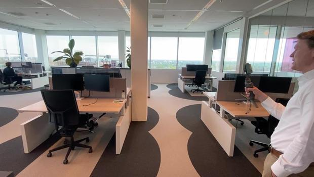Cushman & Wakefield's Jeroen Lokerse explains how color-coded carpeting defines boundaries in the 6 Feet Office project.   / Credit: CBS News