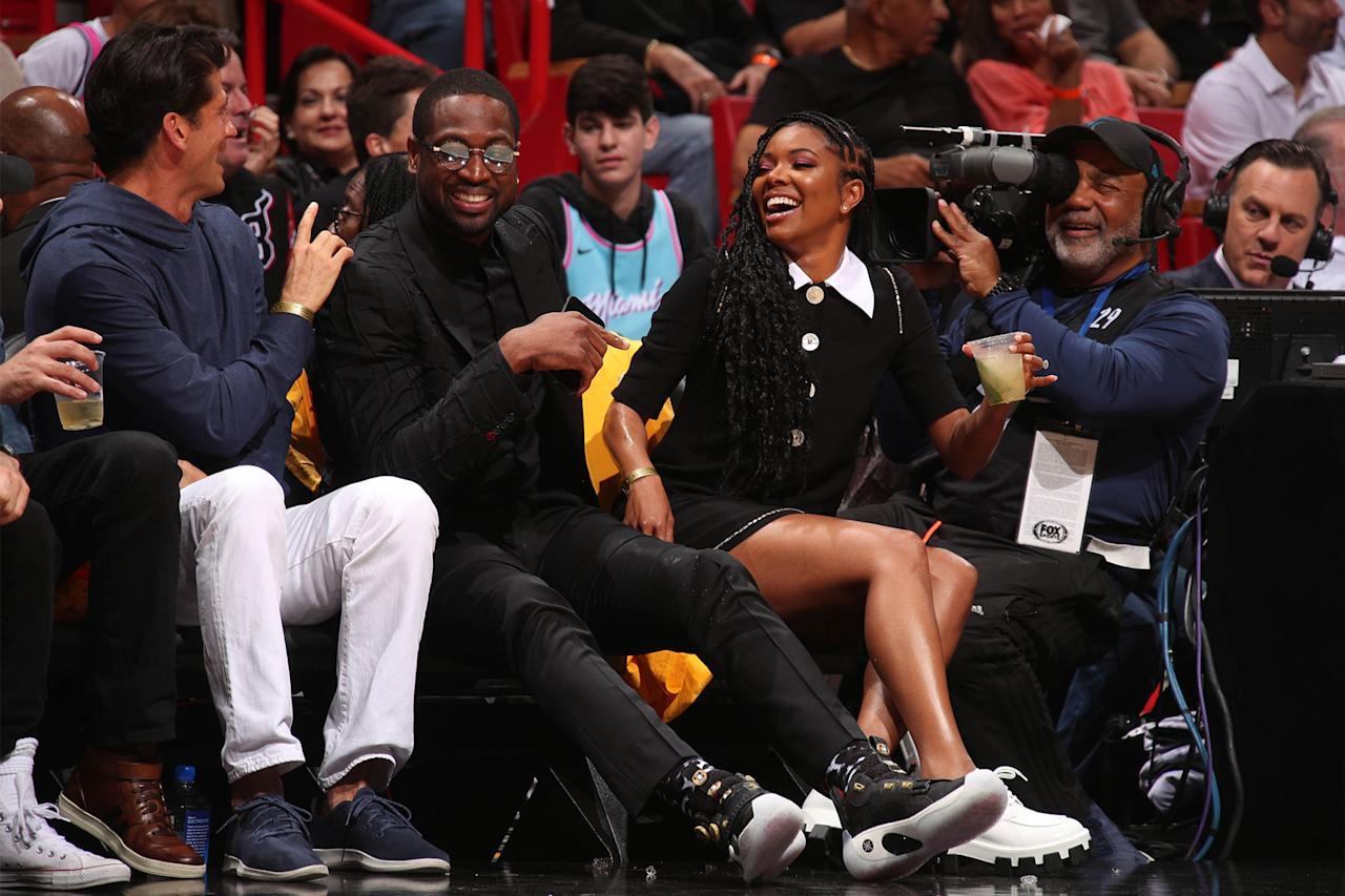 <p>The Wade family laughs on the sidelines during a game between Miami Heat and Cleveland Cavaliers on Saturday in Miami, where Wade's Heat jersey was retired before the match.</p>