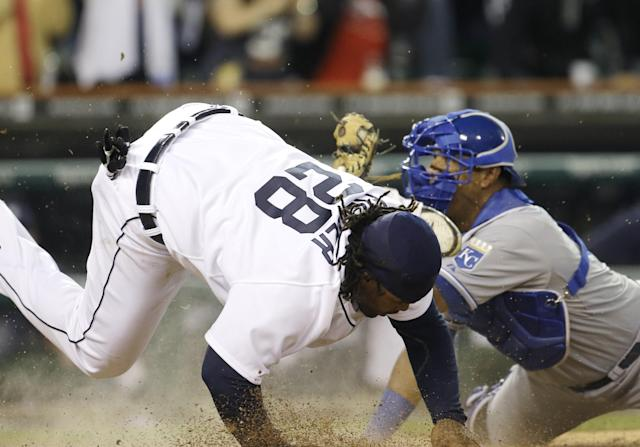 Detroit Tigers' Prince Fielder, left, is tagged out by Kansas City Royals catcher Salvador Perez to end the ninth inning of a baseball game in Detroit, Saturday, Sept. 14, 2013. The Royals won 1-0. (AP Photo/Carlos Osorio)