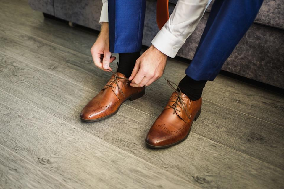 man putting on oxfords, look better after 40