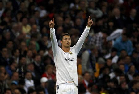 Real Madrid's Cristiano Ronaldo celebrates after scoring his second goal against Juventus during their Champions League soccer match at Santiago Bernabeu stadium in Madrid October 23, 2013. REUTERS/Paul Hanna