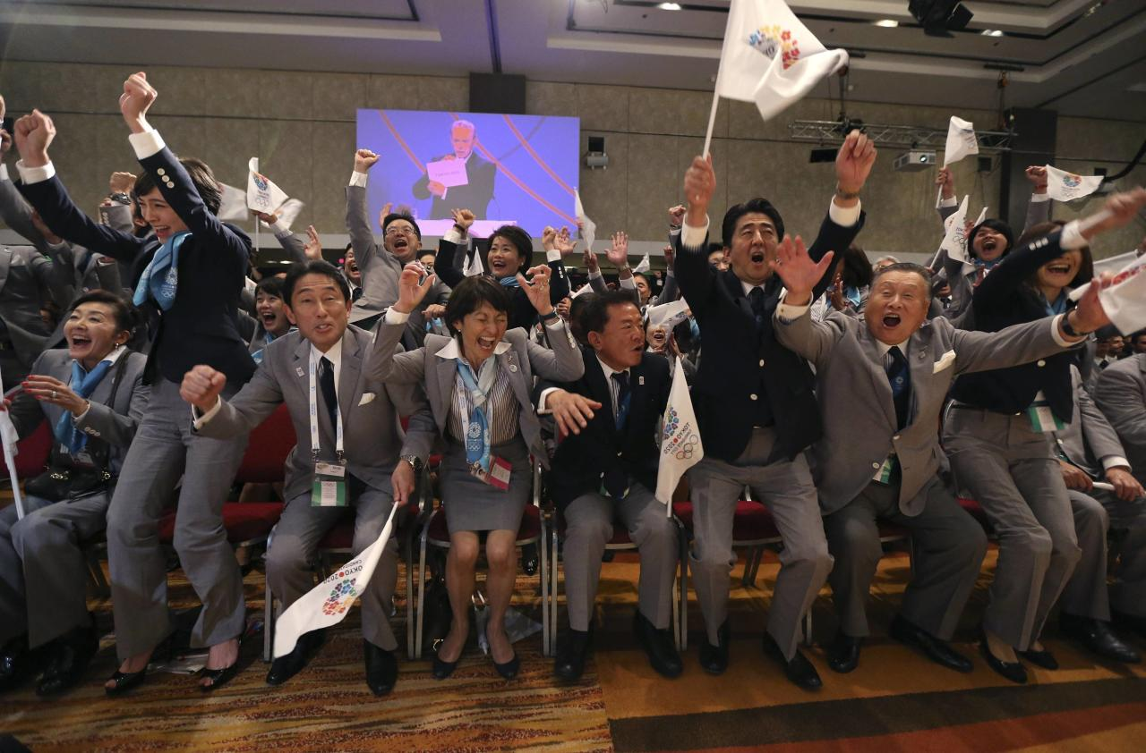 Prime Minister Shinzo Abe of Japan (2nd R) celebrates with members of the Tokyo bid committee as Jacques Rogge President of the International Olympic Committee (IOC) announces Tokyo as the city to host the 2020 Summer Olympic Games during a ceremony in Buenos Aires September 7, 2013. REUTERS/Ian Walton/Pool (ARGENTINA - Tags: SPORT OLYMPICS POLITICS)