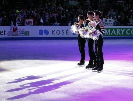 Figure Skating - ISU World Championships 2017 - Men's Victory Ceremony - Helsinki, Finland - 1/4/17 - Gold medallist Yuzuru Hanyu (C) of Japan, silver medallist Shoma Uno (L) of Japan and bronze medallist Jin Boyang of China attend the ceremony. REUTERS/Grigory Dukor