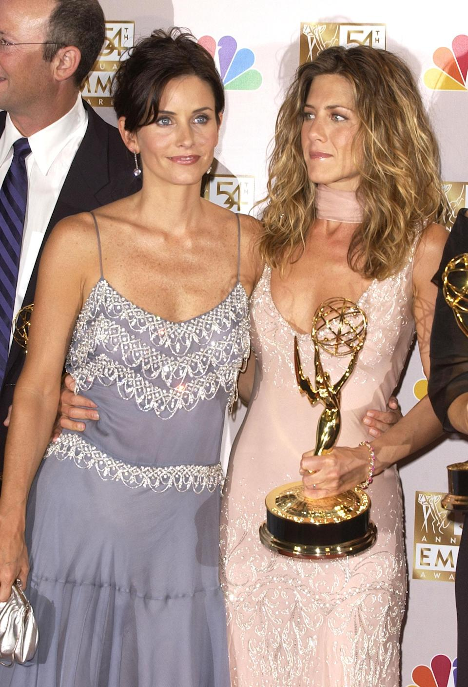 <p>In 2002, Jennifer accepted her Primetime Emmy award in a pale pink dress boasting spaghetti straps and embellishments. Courteney opted for a grey-purple slip, adorned with delicate embroidery. <em>[Photo: Getty]</em> </p>
