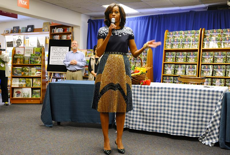 US First Lady Michelle Obama speaks during a book signing event of her book 'American Grown: The Story of the White House Kitchen Garden and Gardens Across America,' at Politics & Prose in Washington, DC, on May 7, 2013. Photo credit: JEWEL SAMAD/AFP/Getty Images