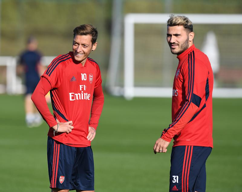 ST ALBANS, ENGLAND - SEPTEMBER 21: (L-R) Mesut Ozil and Sead Kolasinac of Arsenal during a training session at London Colney on September 21, 2019 in St Albans, England. (Photo by Stuart MacFarlane/Arsenal FC via Getty Images)