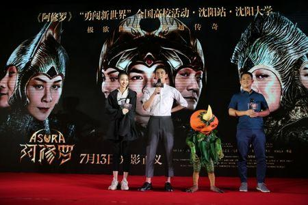 Director Zhang Peng and actors Wu Lei and Zhang Yishang attend a promotional event for the movie