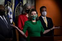 A Senate official ruled that a minimum wage hike to $15 an hour cannot be included in the package but House Speaker Nancy Pelosi said Democrats would continue to fight for it
