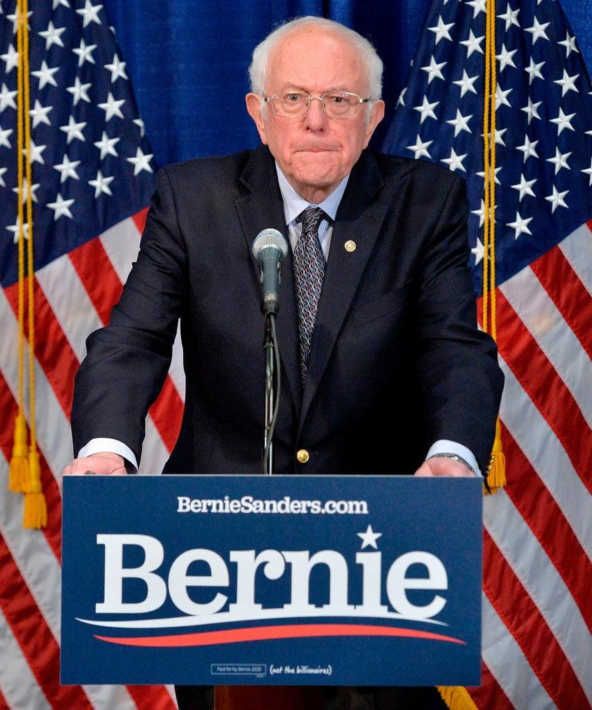 """US Democratic presidential candidate Senator Bernie Sanders(I-VT) speaks to the press after loosing much of super Tuesday to US Democratic presidential candidate and former US Vice President Joe Biden the previous night, in Burlington, Vermont on March 11, 2020. – Senator Bernie Senator said March 11, 2020 he would take part in Sunday's debate with Joe Biden, giving no indication he plans to drop out of the race for the Democratic presidential nomination. """"On Sunday, I very much look forward to the debate in Arizona with my friend, Joe Biden,"""" Sanders said, the day after Biden scooped a series of key wins in the most recent primaries. (Photo by Joseph Prezioso / AFP) (Photo by JOSEPH PREZIOSO/AFP via Getty Images)"""