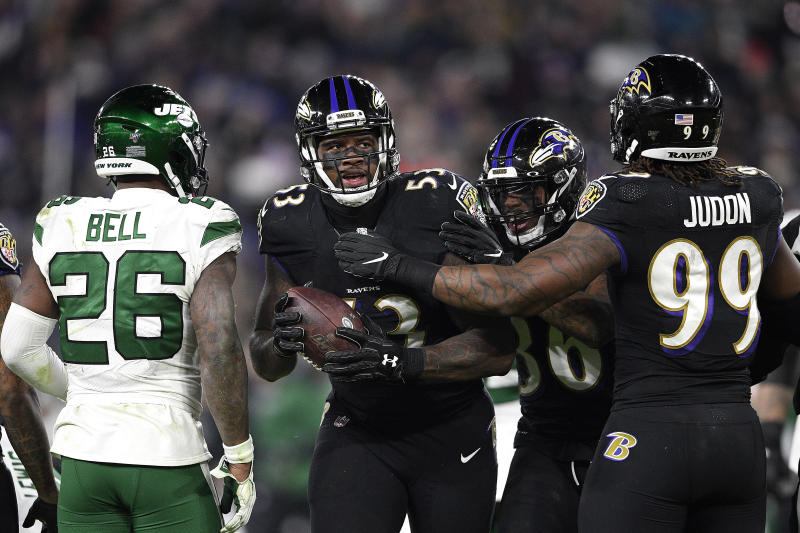 Baltimore Ravens defensive end Jihad Ward, center, is congratulated by teammates after recovering a fumble by New York Jets quarterback Sam Darnold, not visible, during the second half of an NFL football game, Thursday, Dec. 12, 2019, in Baltimore. (AP Photo/Nick Wass)