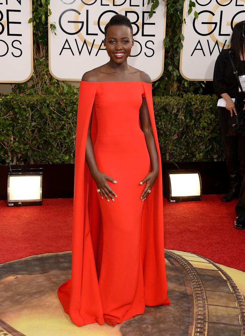 In a Ralph Lauren cape dress atthe 71st Annual Golden Globe Awards held at the Beverly Hilton hotel on Jan. 12, 2014, in Beverly Hills, California.