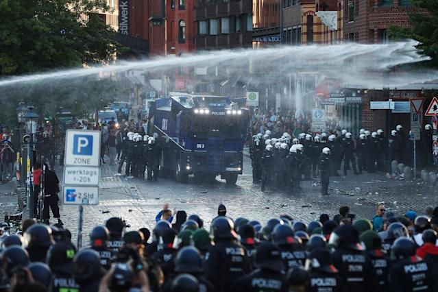 "<p>Riot police use water cannon during the ""Welcome to Hell"" rally against the G-20 summit in Hamburg, northern Germany on July 6, 2017.<br> (Photo: Odd Andersen/AFP/Getty Images) </p>"
