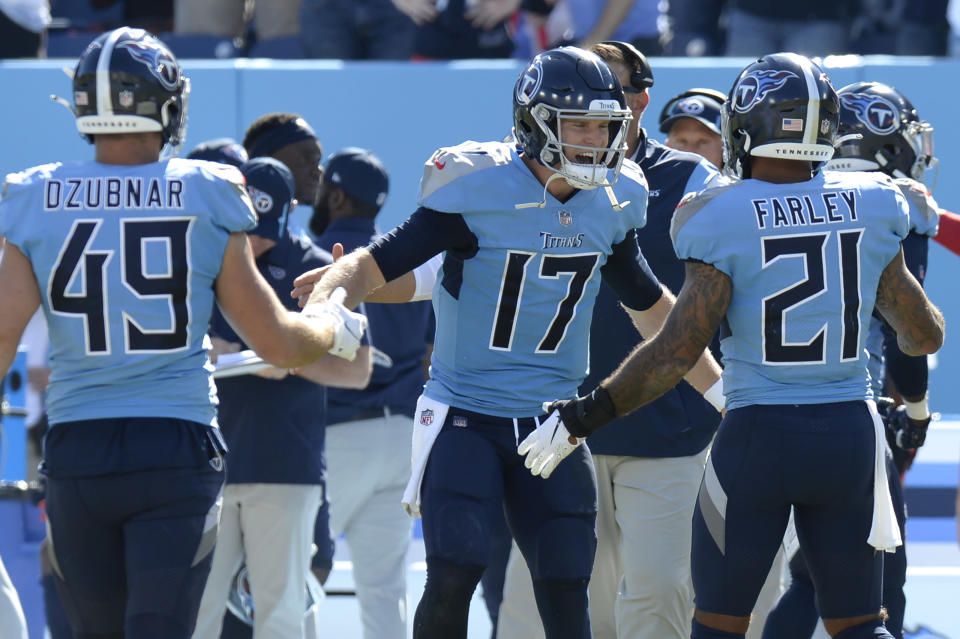 Tennessee Titans quarterback Ryan Tannehill (17) celebrates with defensive back Matthias Farley (21) in the final moments of the fourth quarter during the Titans 25-16 win over the Indianapolis Colts in an NFL football game Sunday, Sept. 26, 2021, in Nashville, Tenn. (AP Photo/Mark Zaleski)