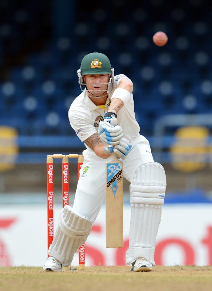 Australian batsman Michael Clarke plays a shot during the final day of the second-of-three Test matches between Australia and West Indies April 19, 2012 at Queen's Park Oval in Port of Spain, Trinidad.