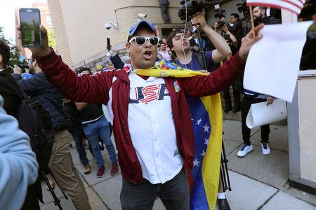 Supporters of Venezuelan opposition leader Juan Guaido celebrate outside the Venezuelan embassy to the United States after U.S. law enforcement officers arrested and removed the remaining activists sympathetic to embattled President Nicolas Maduro who had been part of a multi-week occupation of the embassy in Washington, U.S., May 16, 2019. REUTERS/Jonathan Ernst