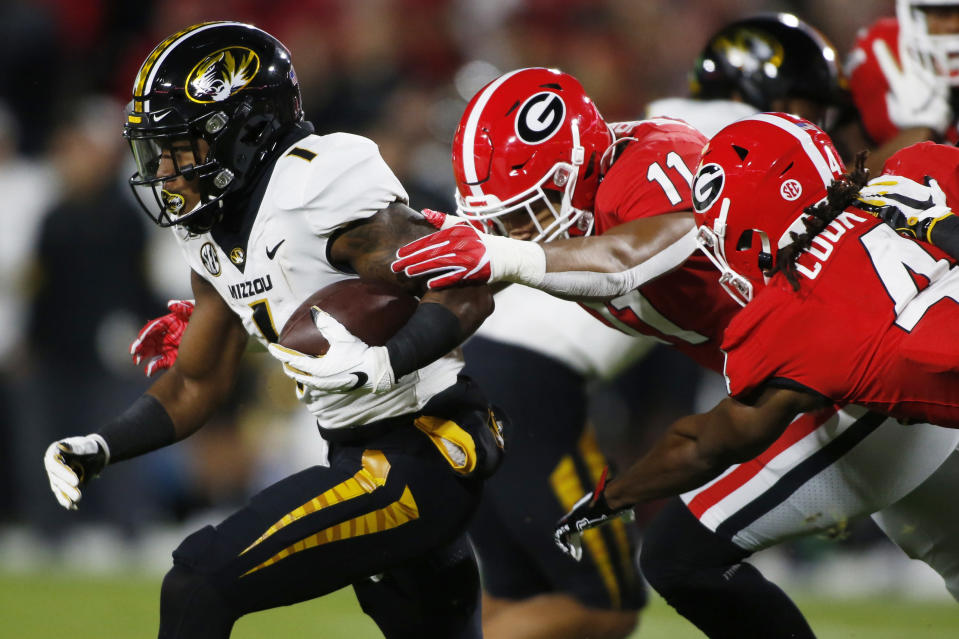 Missouri running back Tyler Badie (1) is taken down by Georgia linebacker Jermaine Johnson (11) and running back James Cook (4) during a kickoff return in the first half of an NCAA college football game in Athens, Ga., on Saturday, Nov. 9, 2019. (Joshua L. Jones/Athens Banner-Herald via AP)