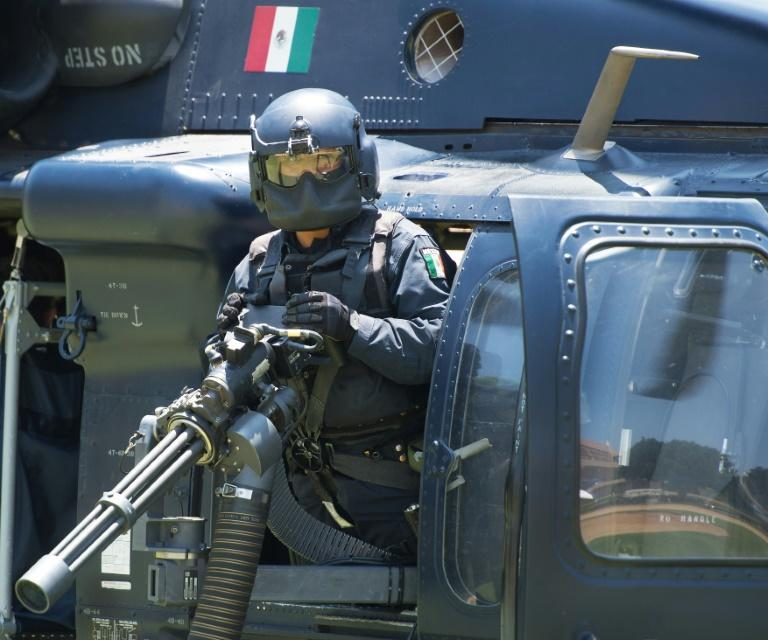 Mexico says it no longer wants helicopter gunships and other weapons from the United States to fight drug cartels, calling for a new approach (AFP/PAUL J. RICHARDS)