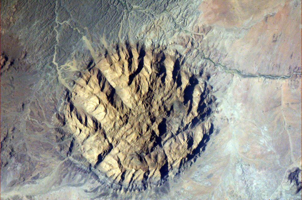 """Lava Carbuncle - an ancient intrusion of tough, hard rock in southwestern Africa. Quite likely also Namibia. <a href=""""https://twitter.com/Cmdr_Hadfield/status/290562463374647296/photo/1/large"""" rel=""""nofollow noopener"""" target=""""_blank"""" data-ylk=""""slk:(Photo by Chris Hadfield/Twitter)"""" class=""""link rapid-noclick-resp"""">(Photo by Chris Hadfield/Twitter)</a>"""