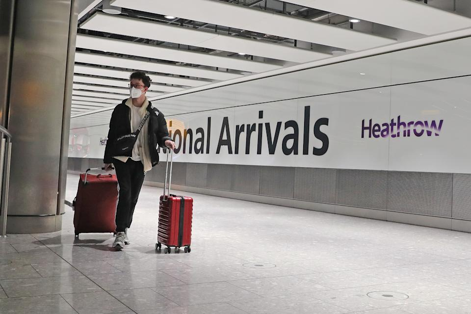 Passengers arrive at Heathrow Airport in London after the last British Airways flight from China touched down in the UK following an announcement that the airline was suspending all flights to and from mainland China with immediate effect amid the escalating coronavirus crisis. (Photo by Steve Parsons/PA Images via Getty Images)
