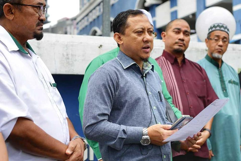 File picture shows PAS Information Chief Kamaruzaman Mohamad speaking to reporters outside the Dang Wangi police station in Kuala Lumpur October 21, 2019. ― Picture by Ahmad Zamzahuri