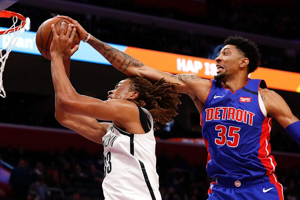 Detroit Pistons' Christian Wood blocks a shot from Brooklyn Nets' Nicolas Claxton in the first half in Detroit, Saturday, Jan. 25, 2020.