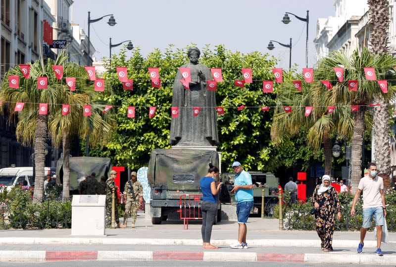 People walk in the center of Tunis
