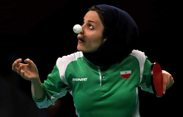 <p>Neda Shahsavari of the Islamic Republic of Iran plays a Women's Singles first round match against Alexandra Privalova of Belarus on Day 1 of the Rio 2016 Olympic Games at Riocentro – Pavilion 3 on August 6, 2016 in Rio de Janeiro, Brazil. (Photo by Mike Ehrmann/Getty Images) </p>