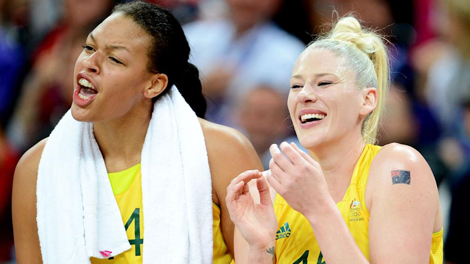 Former Opals teammate Liz Cambage and Lauren Jackson are pictured together on the side of the court.