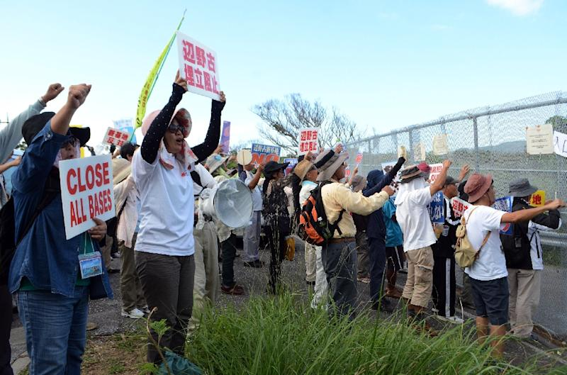 Demonstrators protest against resuming work on a US base in Henoko, in Japan's southern island of Okinawa (AFP Photo/Jiji Press)
