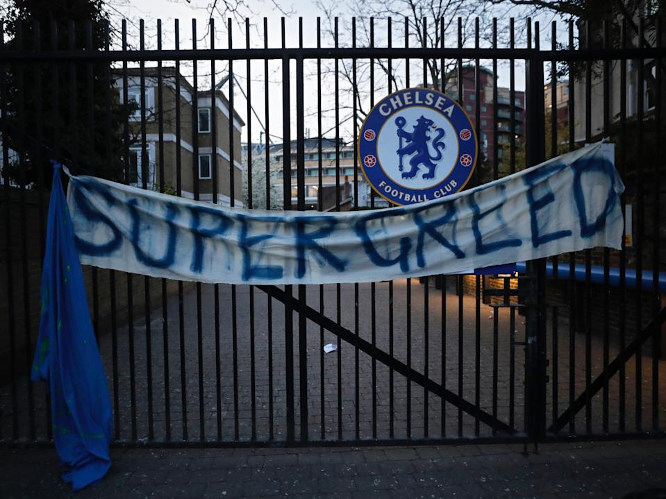 A banner hangs from one of the gates of Stamford Bridge (AP)