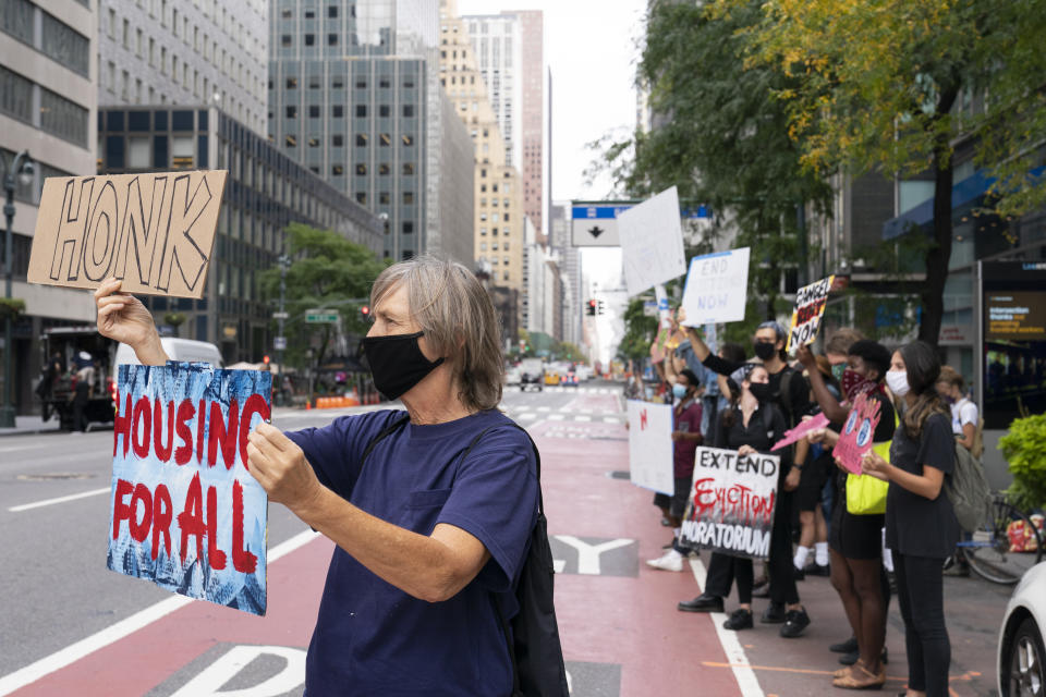 Housing advocates demonstrate outside the building which houses New York Gov. Andrew Cuomo's office, Monday, Sept. 28, 2020, in New York. The activists were demanding immediate safe and stable housing for all the people of New York and that the residential eviction moratorium be extended. (AP Photo/Mary Altaffer)