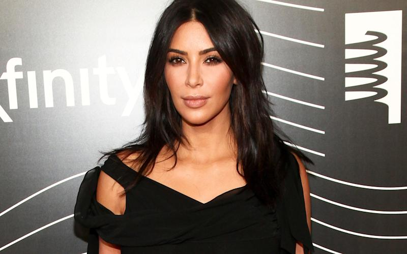 Kim Kardashian West was in a private residence in the French capital when armed men robbed her - AP